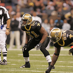 2008 December, 28: New Orleans Saints linebacker Jonathan Vilma (51) looks over the Carolina Panthers offense during a week 17 game between NFC South divisional rivals the Carolina Panthers and the New Orleans Saints at the Louisiana Superdome in New Orleans, LA.