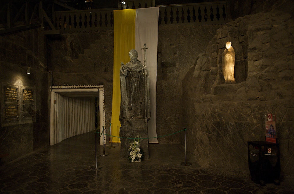 Wieliczka Salt Mine, Poland. On exiting the chapel, visitors can admire the newest of the sculptures which adorn the underground temple. The statue found here is the world's only monument of the Polish pope, John Paul II carved in salt. It was made in 1999