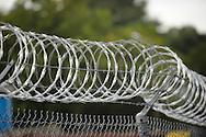 Razor wire around an industrial site