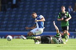 Elliott Bennett of Blackburn Rovers (L) is tackled by Ben Whiteman of Doncaster Rovers - Mandatory by-line: Jack Phillips/JMP - 12/08/2017 - FOOTBALL - Ewood Park - Blackburn, England - Blackburn Rovers v Doncaster Rovers - English Football League One