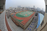 PUTIAN, CHINA - (CHINA OUT) <br /> <br /> Roof Playground<br /> Students do exercise during a PE class at a amazing rooftop playground at Nanmen Middle School in Putian, Fujian Province of China. <br /> ©ChinaFoto/Exclusivepix