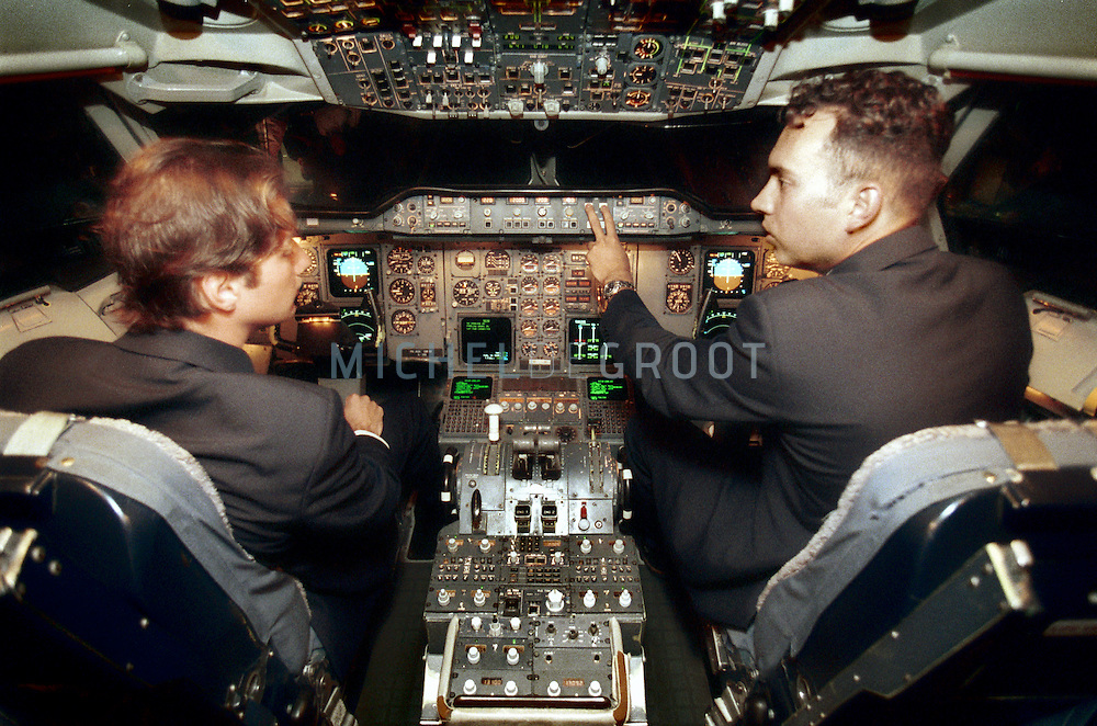 Flight pilot trainees Wessel van Soest en Abdalouhab el Bakkali in a flight simulator at the KLM Flight Academy in Eelde, the Netherlands.