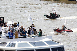 ©  London News Pictures. FIL PIC 15/06/2016. London, UK. BRENDAN COX, husband of Murdered Labour MP Jo Cox, drove a boat  on the Thames during a counter demonstration to the UKIP Thames Flotilla. Jo Cox died after being shot three times in the street near her office by an attacker. Photo credit : Tom Nicholson/LNP