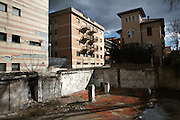 The empty space left by a building collapsed during the earthquake. On 6 April 2009 a strong earthquake hit the city of L'Aquila, in the central Abruzzo region of Italy, leaving 308 dead and tens of thousand homeless. 4  years after In the historical center of the city few signs of reconstructions could be seen. On the other hand the effects of the of abandonment add up to the destruction of the quake. .