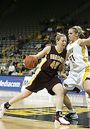 25 JANUARY 2007: Minnesota forward Leslie Knight (45) tries to drive past Iowa forward Krista VandeVenter (51) in Iowa's 80-78 overtime loss to Minnesota at Carver-Hawkeye Arena in Iowa City, Iowa on January 25, 2007.