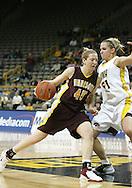 25 JANUARY 2007: Minnesota forward Leslie Knight (45) tries to drive past Iowa forward Krista VandeVenter (51) in Iowa's 80-78 overtime loss to Minnesota at Carver-Hawkeye Arena in Iowa City, Iowa on January 25, 2007.
