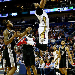 Mar 3, 2016; New Orleans, LA, USA; New Orleans Pelicans forward Anthony Davis (23) dunks over San Antonio Spurs forward Kawhi Leonard (2) during the first quarter of a game at the Smoothie King Center. Mandatory Credit: Derick E. Hingle-USA TODAY Sports