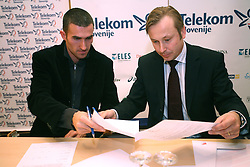 Damjan Zlatnar and president of AZS dr. Peter Kukovica when Athletic Federation of Slovenia (AZS) and top Slovenian athletes sign a contract of sponsorship, on February 14, 2008 in M-Hotel, Ljubljana, Slovenia. (Photo by Vid Ponikvar / Sportal Images)