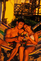 Couple having cocktails on the beach, Reef Club Beach Resort, Isla Cozumel, Mexico