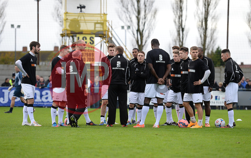 Weston Super Mare Manager, Micky Bell tells his players the game is called off. - Photo mandatory by-line: Alex James/JMP - Mobile: 07966 386802 - 08/11/2014 - SPORT - Football - Weston-super-Mare - Woodspring Stadium - Weston-super-Mare v Doncaster - FA Cup - Round One