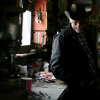 Metal artist Earl Wortman in his Galltin Gateway, Mont., art studio and shop.