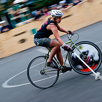 London, UK - 24 August 2012: blurred image of a player at the Hell's Belles Vol 2, Ladies Bike Polo Tournament in Bethnal Green Gardens.
