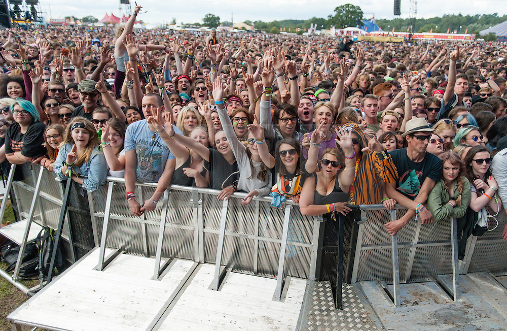 © Licensed to London News Pictures. 28/08/2015. Reading Festival, UK.  Festival goers watch Palma Violets perform on the main stage on Day 1 of the festival Photo credit: Richard Isaac/LNP