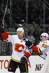 Feb 8, 2012; San Jose, CA, USA; Calgary Flames center Olli Jokinen (13) is congratulated by left wing Mike Cammalleri (93) after scoring a goal against the San Jose Sharks during the second period at HP Pavilion. Calgary defeated San Jose 4-3. Mandatory Credit: Jason O. Watson-US PRESSWIRE
