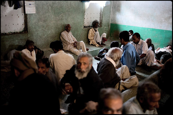 "Patients of the Edhi Rehab clinic for drug users sit in a common room. Karachi, Pakistan, on sunday, December 07 2008.....""Pakistan is one of the countries hardest hits by the narcotics abuse into the world, during the last years it is facing a dramatic crisis as it regards the heroin consumption. The Unodc (United Nations Office on Drugs and Crime) has reported a conspicuous decline in heroin production in Southeast Asia, while damage to a big expansion in Southwest Asia. Pakistan falls under the Golden Crescent, which is one of the two major illicit opium producing centres in Asia, situated in the mountain area at the borderline between Iran, Afghanistan and Pakistan itself. .During the last 20 years drug trafficking is flourishing in the Country. It is the key transit point for Afghan drugs, including heroin, opium, morphine, and hashish, bound for Western countries, the Arab states of the Persian Gulf and Africa..Hashish and heroin seem to be the preferred drugs prevalence among males in the age bracket of 15-45 years, women comprise only 3%. More then 5% of whole country's population (constituted by around 170 milion individuals),  are regular heroin users, this abuse is conspicuous as more of an urban phenomenon. The substance is usually smoked or the smoke is inhaled, while small number of injection cases have begun to emerge in some few areas..Statistics say, drug addicts have six years of education. Heroin has been identified as the drug predominantly responsible for creating unrest in the society."""