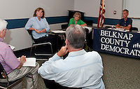 Carol Shea-Porter (far left) and Andrew Hosmer (far right) address questions asked by Belknap County Democrats Tuesday evening at the Laconia Police Station.  (Karen Bobotas/for the Laconia Daily Sun)