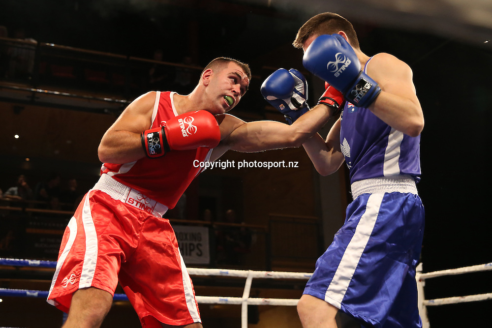Daniel Parkin of New Zealand (red) fights Campbell Somerville of Australia (blue) in the 2016 Trans-Tasman Boxing Championships at Vodafone Events Centre, Manukau, Auckland on Friday, Feb 19, 2016. Photo: Fiona Goodall/Photosport.nz