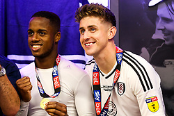 Free to use courtesy of Sky Bet. Tom Cairney and Ryan Sessegnon smile as Fulham celebrate in the dressing room after winning the game 0-1 to win the Sky Bet Championship Play-Off Final and secure Promotion to the Premier League - Rogan/JMP - 26/05/2018 - FOOTBALL - Wembley Stadium - London, England - Aston Villa v Fulham - Sky Bet Championship Play-Off Final.