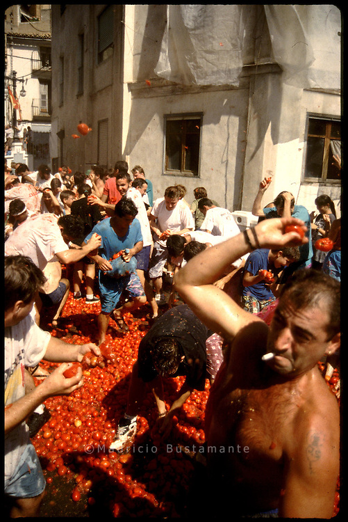 Tomato Fight.Situated thirty miles inland from Valencia is the town of Buñol, scene of what must rank as the most bizarre festival in Spain. La Tomatina, which is held on the last Wednesday of August, is a full blown tomato fight which involves 35,000 people fueled by copious quantities of wine and consumes some 50,000 kilos of tomatoes. To say that the streets run red is no