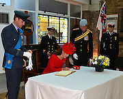 03.JUNE.2012. LONDON<br /> <br /> KATE MIDDLETON, CATHERINE DUCHESS OF CAMBRIDGE SIGNING THE ROYAL GUEST BOOK AT HMS PRESIDENT. EARLIER, THE QUEEN AND PRINCE PHILIP WERE ONBOARD THE ROYAL BARGE, THE SPIRIT OF CHARTWELL WITH SEVERAL OTHER ROYAL FAMILY MEMBERS CELEBRATING THE QUEEN'S DIAMOND JUBILEE PAGEANT ON THE RIVER THAMES IN LONDON<br /> <br /> BYLINE: EDBIMAGEARCHIVE.CO.UK<br /> <br /> *THIS IMAGE IS STRICTLY FOR UK NEWSPAPERS AND MAGAZINES ONLY*<br /> *FOR WORLD WIDE SALES AND WEB USE PLEASE CONTACT EDBIMAGEARCHIVE - 0208 954 5968*