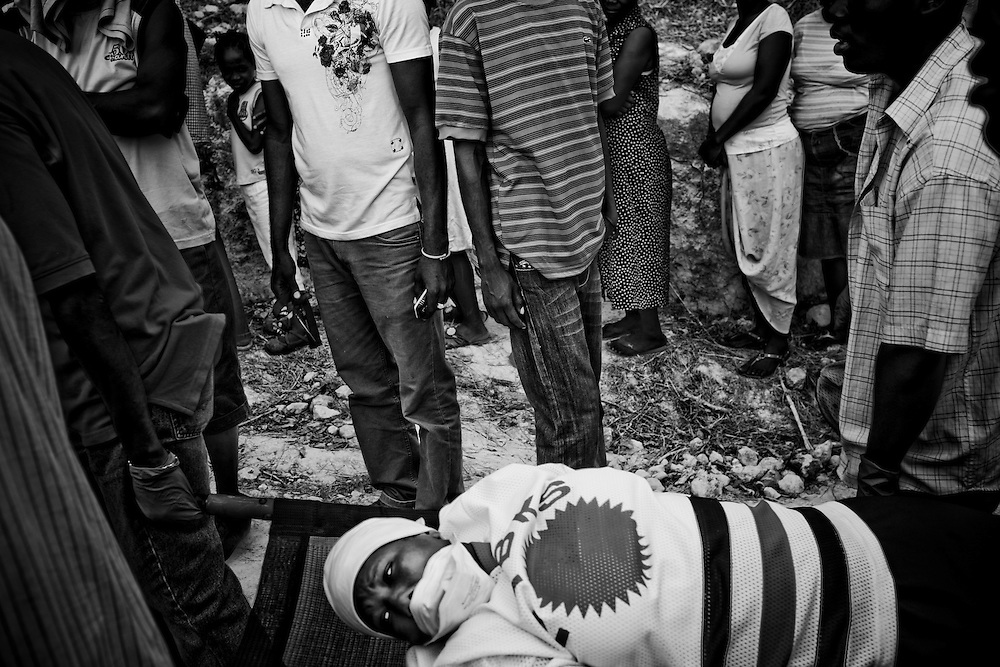 A woman is carried on a stretcher in a camp for those displaced by the recent earthquake in Petionville, outside  Port-au-Prince, Haiti.