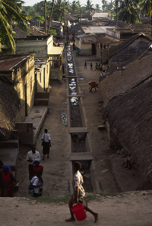 View of an alley in the Macuti Town in Ilha de Mozambique. Macuti Town is where most of islands population live and the its sanitary system is non-existent.