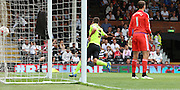 Sam Baldock scoring the first goal for Brighton during the Sky Bet Championship match between Fulham and Brighton and Hove Albion at Craven Cottage, London, England on 15 August 2015. Photo by Matthew Redman.