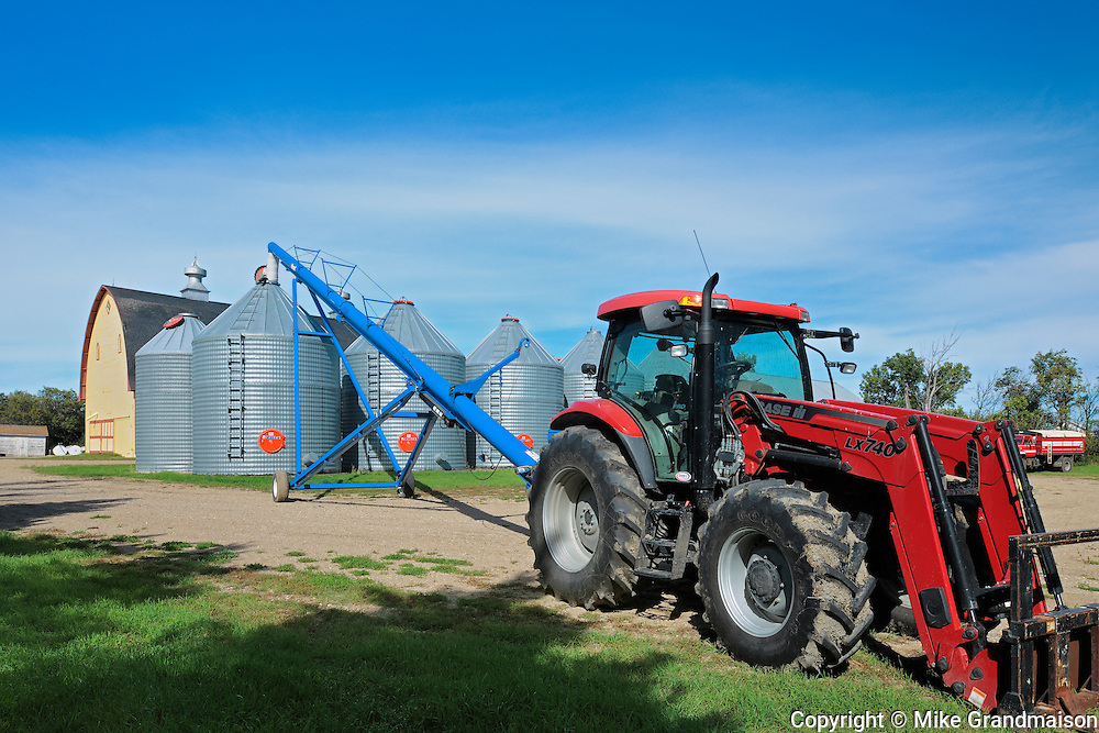 Grain bins, tractor and auger  in farmyard - Property Released<br /> Yellow Grass<br /> Saskatchewan<br /> Canada
