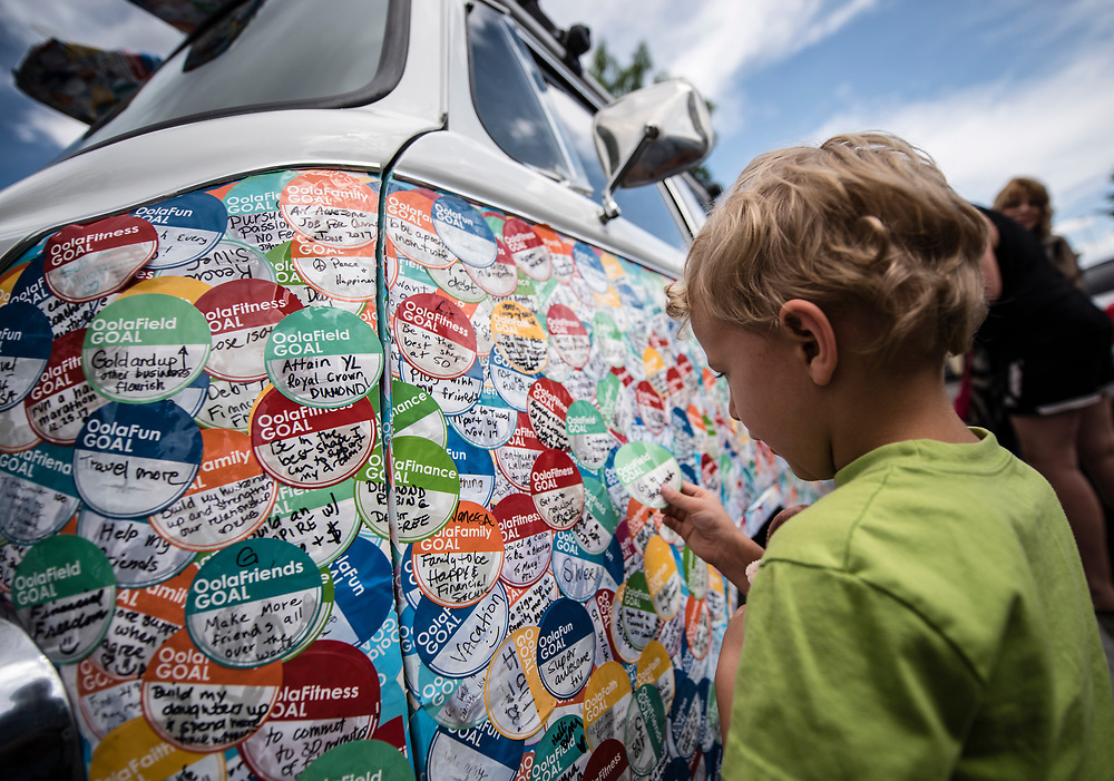 rer0605d/Metro/June 05, 2017/Albuquerque Journal<br /> Four year old David Orfield(Cq) places his dream sticker on the Oola Dream Tour van. David's dream read &quot; go to the beach.&quot;  The Oola Dream Tour  consists of the duo Braun and Troy Amdahl(Cq) traveling cross county in a 1970 VW surfer bus visiting all 50 states  collecting dreams in the form of handwritten stickers stuck to the sides and front of the Oola Bus.  On Monday the bus stopped by the Barnes and Noble store at Coronado mall where folks came out to place their dreams on its side. <br />  Roberto E. Rosales/Albuquerque Journal
