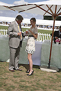 Paul Barton and his daughter Mischa Barton, Cartier International Polo. Guards Polo Club. Windsor Great Park. 30 July 2006. ONE TIME USE ONLY - DO NOT ARCHIVE  © Copyright Photograph by Dafydd Jones 66 Stockwell Park Rd. London SW9 0DA Tel 020 7733 0108 www.dafjones.com