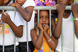 Children gather to meet Prince Harry as he attends a St Lucian street festival in Soufriere on the island of St Lucia during the second leg of his Caribbean tour.