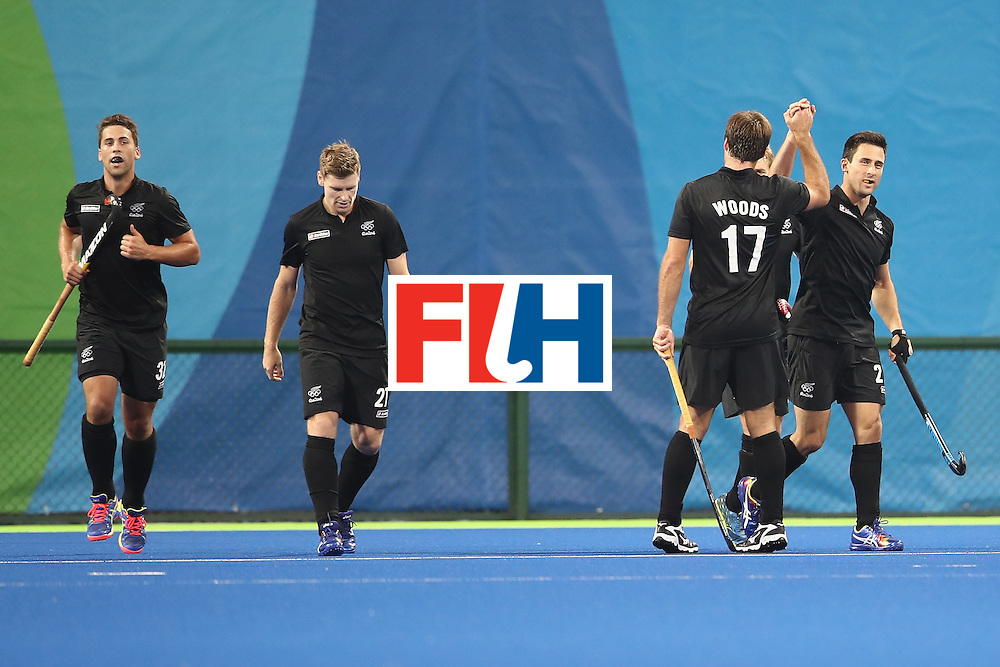 RIO DE JANEIRO, BRAZIL - AUGUST 07:   Kane Russell of New Zealand celebrates with his team mates after scoring a goal during the men's pool A match between Great Britain and New Zealand on Day 2 of the Rio 2016 Olympic Games at the Olympic Hockey Centre on August 7, 2016 in Rio de Janeiro, Brazil.  (Photo by Mark Kolbe/Getty Images)