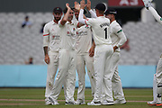Graham Onions congratulated by his team mates during the Specsavers County Champ Div 1 match between Lancashire County Cricket Club and Essex County Cricket Club at the Emirates, Old Trafford, Manchester, United Kingdom on 9 June 2018. Picture by George Franks.