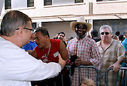"""Richard Vasquez greets David Hill  during the Paradise Garage Party """"Larry Levan Day"""" event on King Street in New York City, New York on May 11, 2014."""