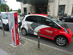 Flinkster DB carsharing electric  car being recharged on street in Berlin German