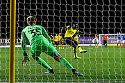 Alex Bass (35) of Portsmouth dives the wrong way but Daniel Agyei (23) of Oxford United misses his penalty during the shoot out at full time after a 2-2 draw during the Leasing.com EFL Trophy match between Oxford United and Portsmouth at the Kassam Stadium, Oxford, England on 8 October 2019.
