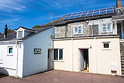 Solar power roof panels on the roof on a commercial launderette in Wadebridge, Cornwall, UK.