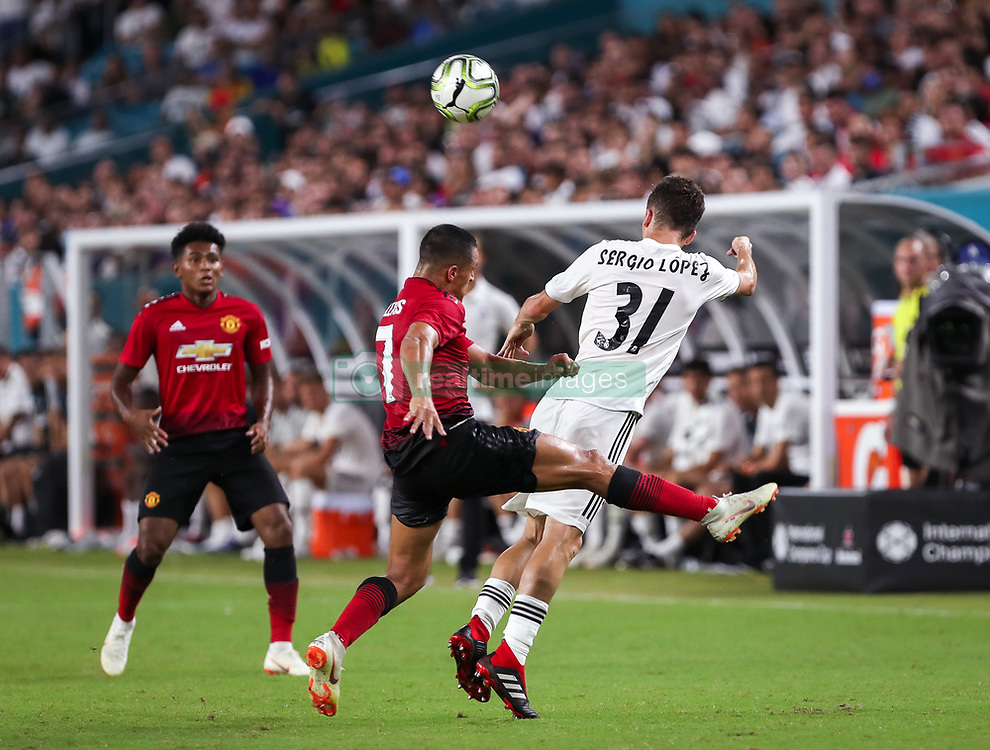 July 31, 2018 - Miami Gardens, Florida, USA - Manchester United F.C. forward Alexis Sanchez (7) (left) disputes the ball with Real Madrid C.F. defender Sergio Lopez (31) (right) during an International Champions Cup match between Real Madrid C.F. and Manchester United F.C. at the Hard Rock Stadium in Miami Gardens, Florida. Manchester United F.C. won the game 2-1. (Credit Image: © Mario Houben via ZUMA Wire)