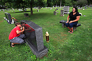 "Teresa Cunningham helps her son Liam remember his father Michael ""Micky""  Cunningham by making the cemetery a place he can feel happy to be with his dad.  Liam, 9, was only 12 days old when his dad was killed on 9/11. Liam teases his mom by hiding behind his dad's headstone as they visit the grave."