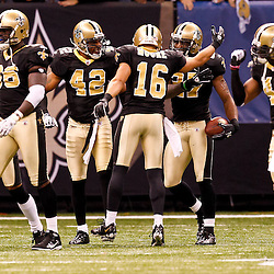 December 12, 2010; New Orleans, LA, USA; New Orleans Saints cornerback Malcolm Jenkins (27) celebrates with teammates following an interception return for a touchdown against the St. Louis Rams during the first half at the Louisiana Superdome. Mandatory Credit: Derick E. Hingle-US PRESSWIRE