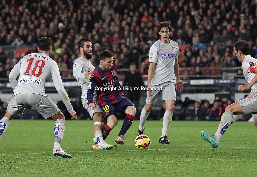 11.01.2015. Barcelona, Spain. La liga football. Barcelona versus Atletico Madrid.  Messi in action challenged by Arda