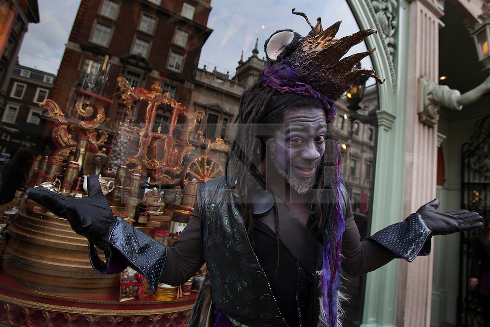 © licensed to London News Pictures. London, UK 13/11/2012. Cast members of Dick Whittington and his Cat at the Hackney Empire helping the launch of new window of Fortnum & Mason in Piccadilly, London. Photo credit: Tolga Akmen/LNP