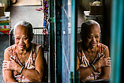 "Exploring a building I hadn't yet been to in a favorite stops on my photo tours, I hear a voice in near perfect English say ""Hello, how are you?"" A little surprised, I turn around to meet Hoa, 84, who goes on to tell me she used to work for the US at Saigon airport during the war. She says she forgot all her English, but it's still pretty sharp. I stopped by again on last week's tour and she was super happy to have visitors again. I'll be sure to swing by on tomorrows tour as well :) Image by @quinnryanmattingly"