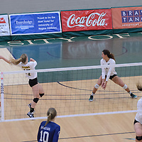 1st year setter Kirstin Greve (17) of the Regina Cougars 3rd year outside hitter Ashlee Sanford (1) of the Regina Cougars in action during the Women's Volleyball Home Game vs Trinity Western  on October 28 at the CKHS University of Regina. Credit Matt Johnson/Arthur Images