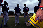 024222.SP.0114.angels18.kc--San Pedro de Macoris, Dominican Republic--Roving outfield instructor Bruce Hines(right, not shown) holds his pockets Spanish  dictionary as he goes over the common phrases with players who know mostly Spanish. They learn English with the hopes of one day playing in the US. At a young age Dominican boys learn that baseball could be their chance to make it big. The baseball academies run by MLB teams provides an all around learning experience for boys once they reach sixteen.