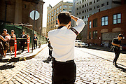 wedding photographer at work in DUMBO Brooklyn ny