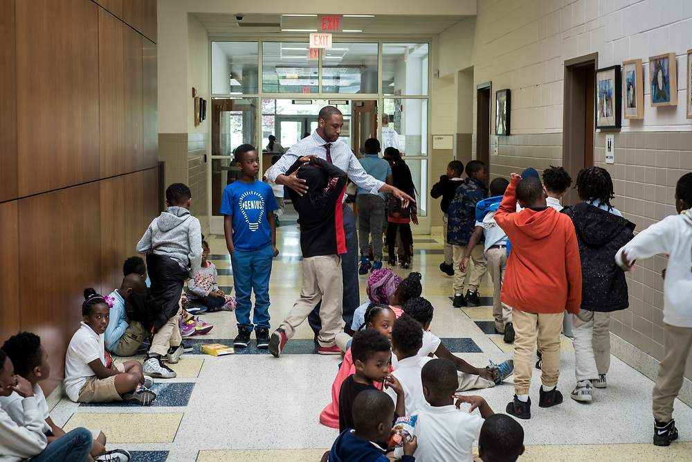 Eric Bethel, principal, at Turner Elementary School in Washington, D.C., wrangles students on the way to lunch on Thursday, May 4, 2017.