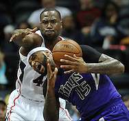 December 18, 2013 - Atlanta:  The  intensity on Elton Brand's face combined with DeMarcus Cousins reaction and him loosing the ball makes this a good basketball photo.   Atlanta Hawks Elton Brand (42) hits Sacramento Kings DeMarcus Cousins (15) in the  head as he reaches for the ball during the Atlanta Hawks vs the Sacramento Kings basketball game on Wednesday, December 18, 2013, in Philips Arena.  Camera Nikon D3, Lens  300mm f2.8, ISO 2500, Aperture f2.8, Shutter speed 1/1000.  ©2013 Johnny Crawford