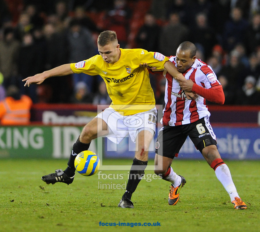 Picture by Richard Land/Focus Images Ltd +44 7713 507003.01/12/2012.Matthew Hill of Sheffield Utd and Tom Pope of Port Vale during the The FA Cup match at Bramall Lane, Sheffield.