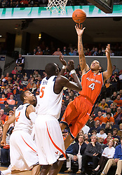 Auburn forward Lucas Hargrove (4) shoots over Virginia guard Calvin Baker (4) and center Assane Sene (5).  The Auburn Tigers defeated the Virginia Cavaliers 58-56 at the University of Virginia's John Paul Jones Arena  in Charlottesville, VA on December 20, 2008.  (Special to the Daily Progress / Jason O. Watson)